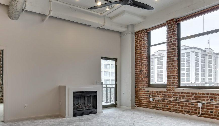 Condo for sale, Omaha, nebraska, downtown condo, 2 bedroom, 2 bathroom, open floor plans, living room with fireplace