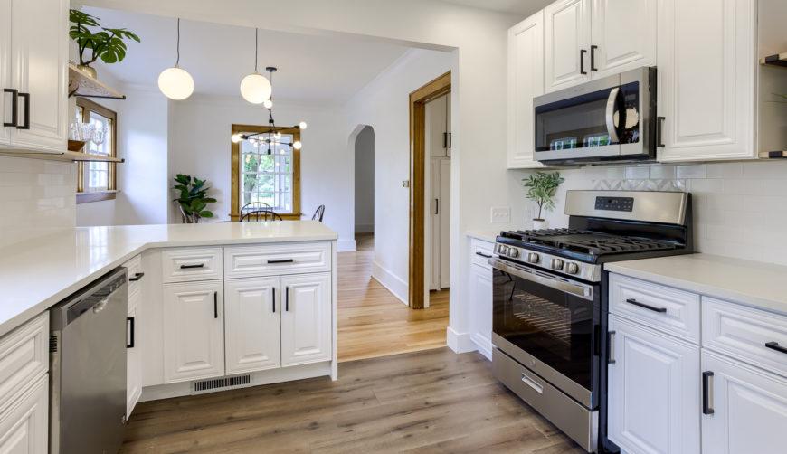 gorgeous white kitchen, open floor plan, stainless steel appliances