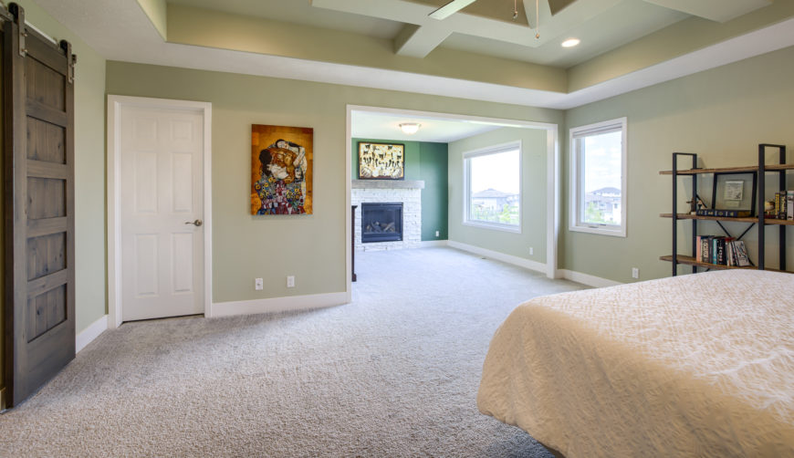 grand master suite with sitting room and fireplace