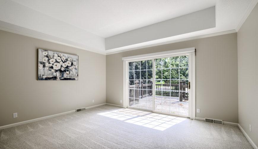 Oversized windows, patio doors leading to deck