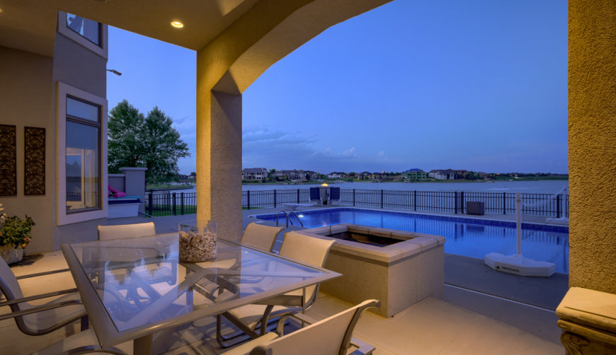 Covered patio with amazing pool and lake views
